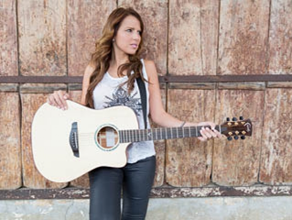 South African singer-songwriter Louise Day chooses Faith Guitars.